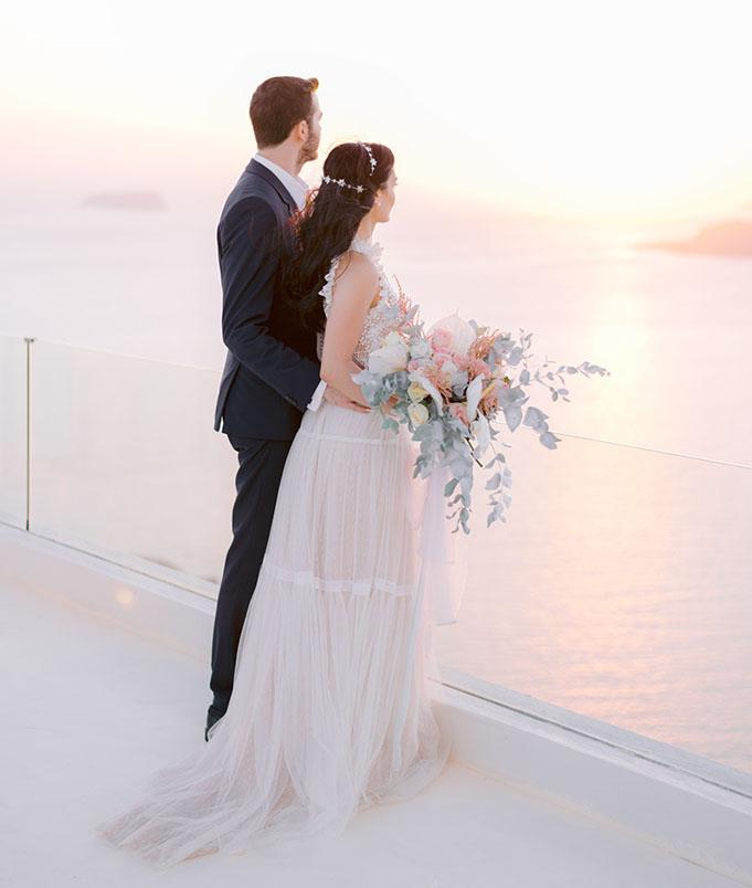 Sunset wedding Santorini - caldera cliff wedding